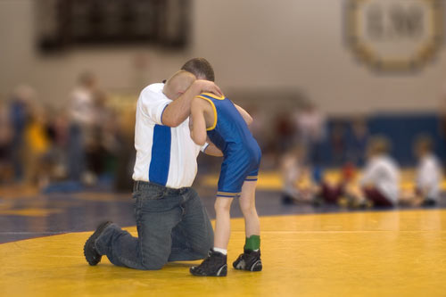 coach-comforting-crying-athlete_web