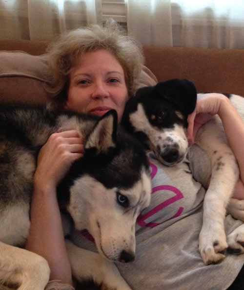 QA Tester Jennie Neusch shares a little quality time with her pups.