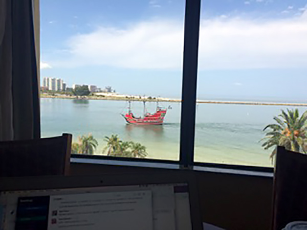 "One of my favorite ""take advantage of TeamSnap's benefits"" memories so far this year has been visiting my mom in FL where I was able to work with this amazing view for a couple of days, complete with a pirate ship! - Terri Schmier, director of product management"