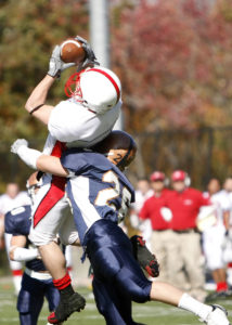 Football Leaping Catch