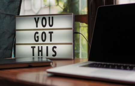 you got this sign next to a macbook