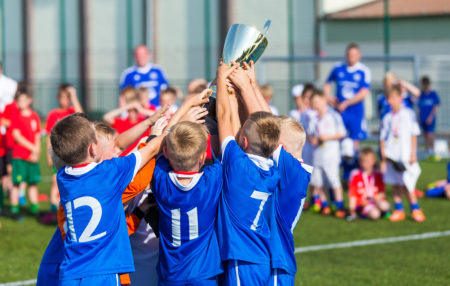 photo of a soccer team winning a trophy