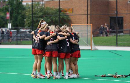 photo of a girls lactosse team huddled