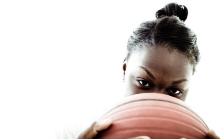 photo of a woman with a basketball